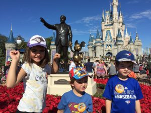 The kids in front of Cinderella's Castle.