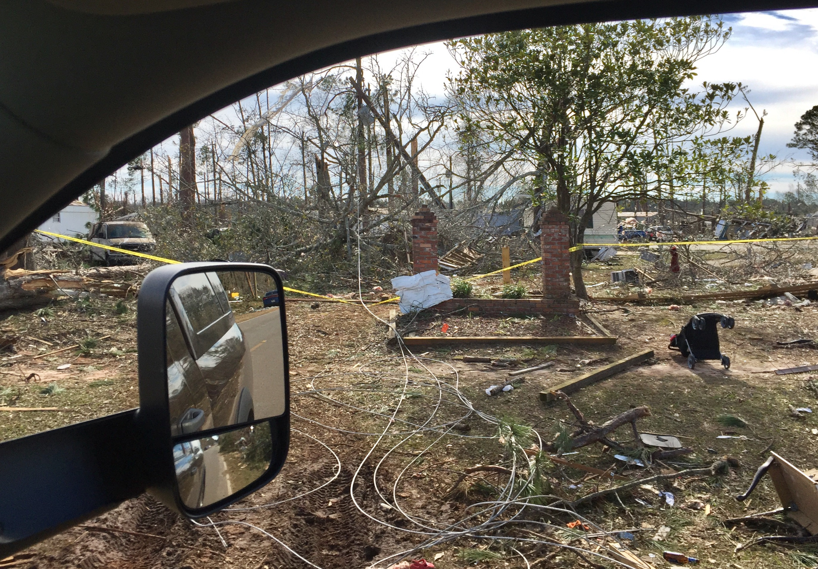 Passing the devastation in a hard hit neighbourhood in Albany, Georgia
